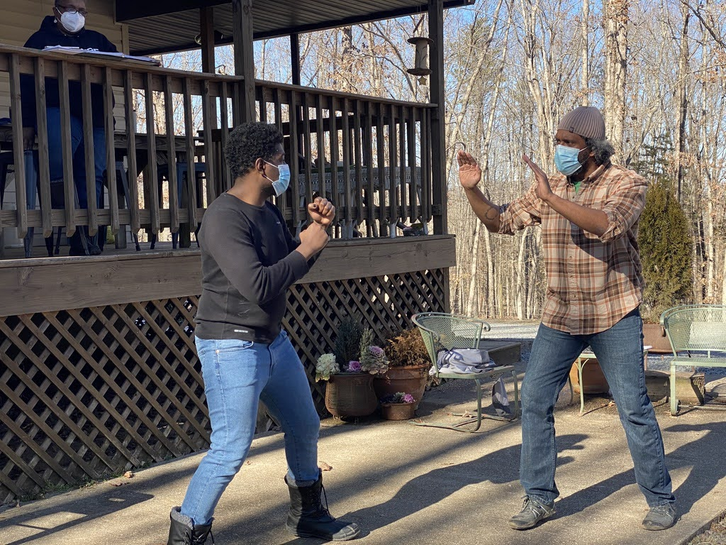Brennen S. Malone and Lindsay Smiling rehearse fight choreography